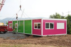WEIRO® containers, connected to form an office container system, painted in several colors